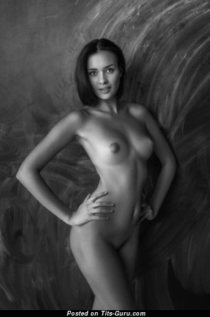 Image. Naked nice female with medium natural tittes photo