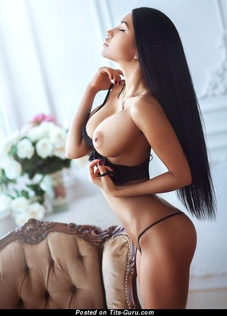 Image. Sexy topless brunette with fake tits pic