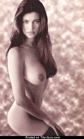 Image. Manuela Arcuri - sexy topless brunette with medium natural boobies and big nipples pic