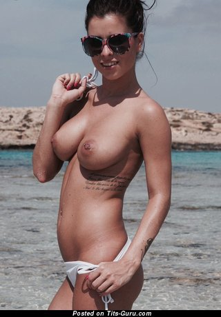 Image. Sexy naked brunette with medium natural tits and piercing pic