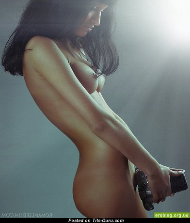 Image. Nude brunette with medium tittes photo