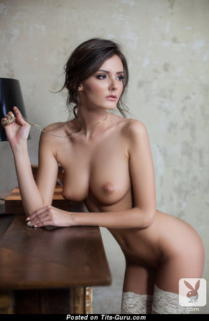 Image. Naked nice lady with medium natural tits photo