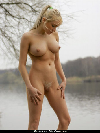 Amateur naked blonde with medium boobs photo