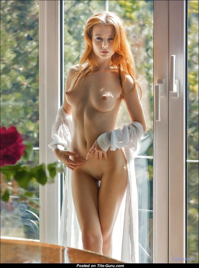 red hair babe with exposed real medium sized hooters porn
