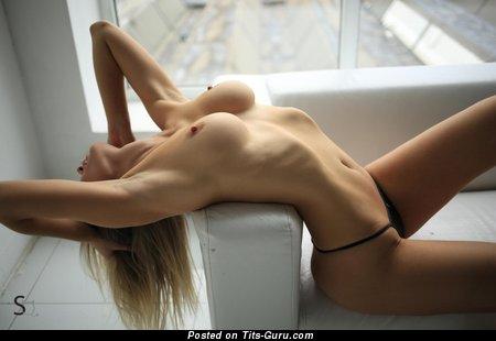 Sexy topless wonderful lady with medium boob photo