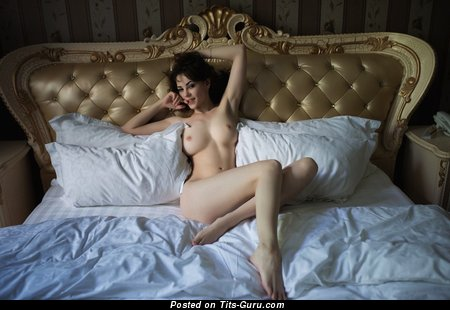 Image. Nude brunette with medium natural boobs pic