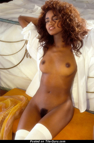Image. Sexy topless ebony with natural tots photo