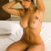 Wonderful female with big tittys and tattoo pic