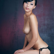 Asian with medium natural tittes photo