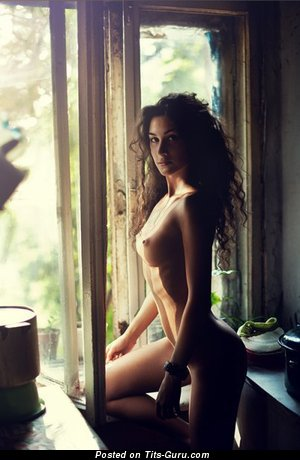 Image. Sexy topless amateur brunette with medium tittes picture