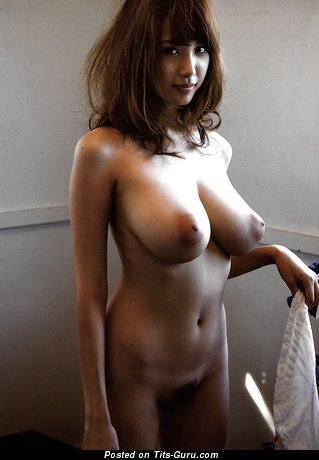 Sexy nude asian brunette with medium natural tittes photo