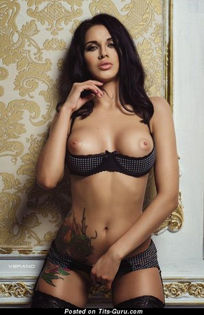 Sexy nude brunette with piercing and tattoo pic