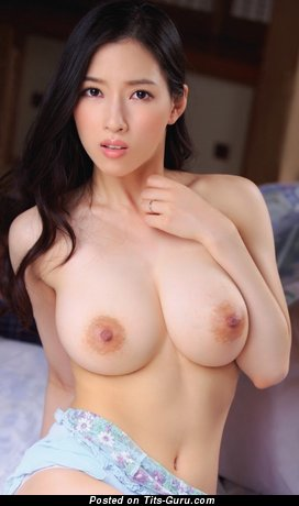 Sexy topless asian with medium natural tits pic