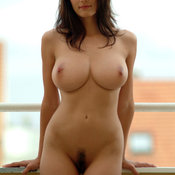 Sexy topless brunette with medium natural tittes pic