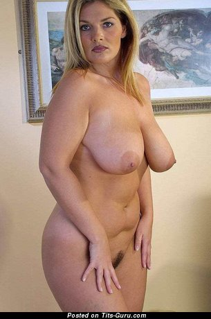 Naked blonde with medium natural tots pic