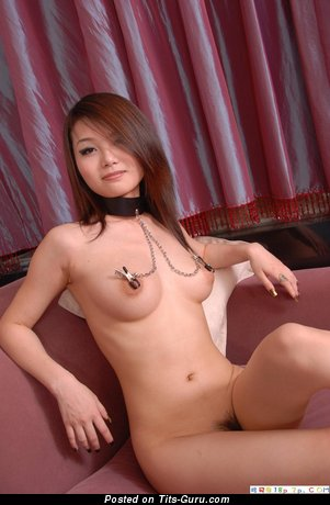 Image. Naked asian brunette with medium natural breast image