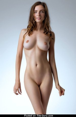 Image. Naked brunette with medium natural boobies photo