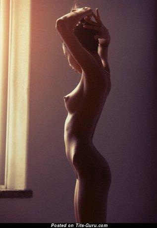 Naked hot girl with medium natural breast image