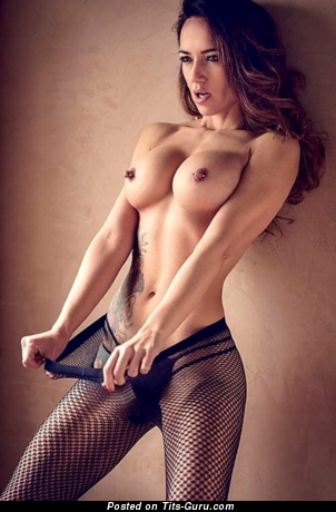 Cute Topless Brunette Babe with Cute Bald Silicone Med Melons, Inverted Nipples, Piercing & Tattoo (18+ Photo)