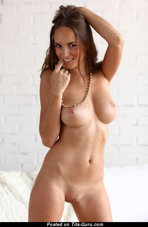 Image. Awesome female with medium natural boob and piercing image