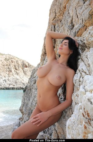 Image. Lucy Li - nude brunette with medium natural boobies image