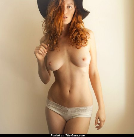 Topless red hair with medium natural tittes picture