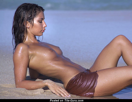 Image. Wet topless brunette with small natural tittes photo