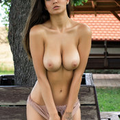 Sexy topless awesome female with medium natural boob pic