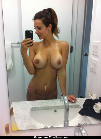 Image. Nude brunette with medium natural breast selfie