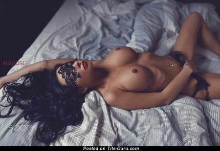 Image. Sexy topless brunette with big boob image
