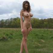 Sexy topless amateur brunette with medium natural boobies photo