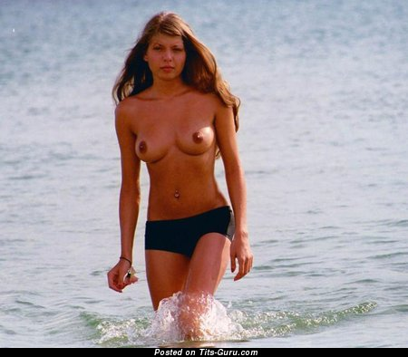 Sexy topless amateur awesome female with medium natural tits photo