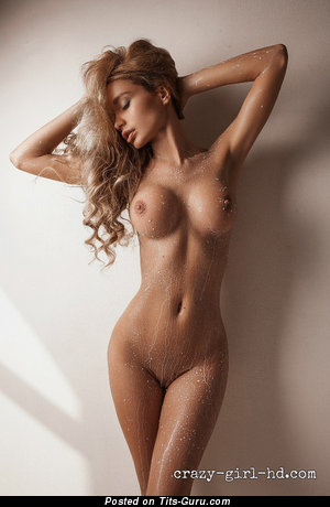 Yummy Wet Playboy Blonde with Yummy Exposed Round Fake Firm Titties (Sexual Pic)