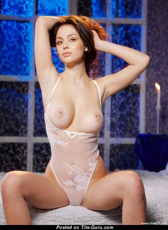 Image. Nude brunette with medium natural breast photo