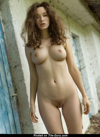 Sexy nude beautiful lady with medium natural tits photo