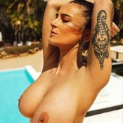 Sexy topless hot woman with medium natural tittys photo