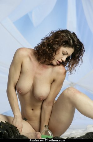 Image. Naked brunette with big natural boob photo