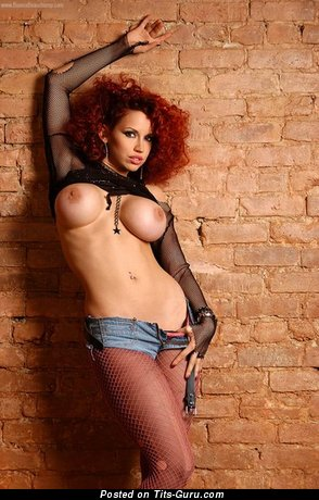 Image. Topless red hair with big fake tits image