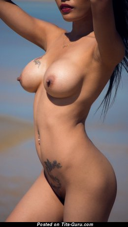 Image. Sexy nude nice lady with fake tittys and tattoo picture