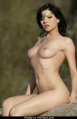 Image. Nude brunette with medium natural tits image