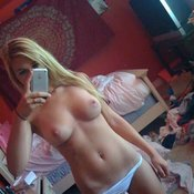 Amateur beautiful woman with medium tits selfie