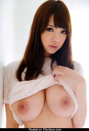 Sexy topless asian brunette with big nipples picture
