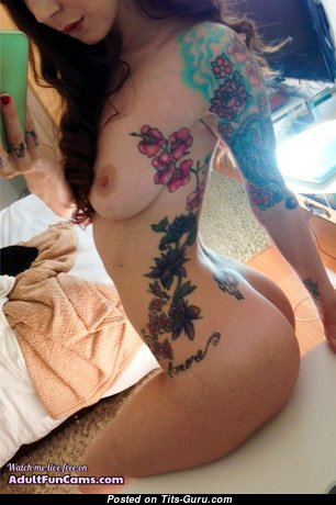Good-Looking Nude Brunette Babe with Long Nipples, Tattoo is Undressing (on Public Sexual Picture)