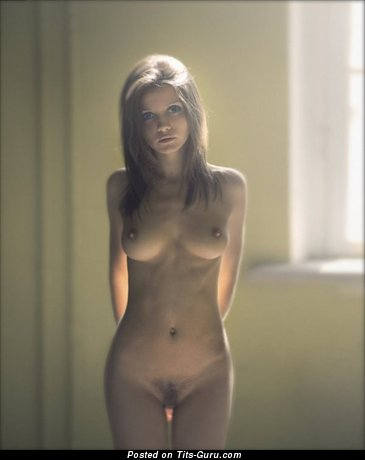 Image. Naked wonderful lady with medium natural boobs photo