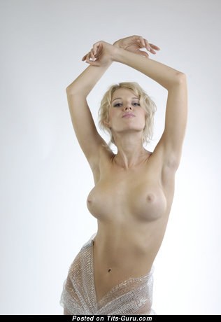 Image. Topless blonde with medium boobies pic