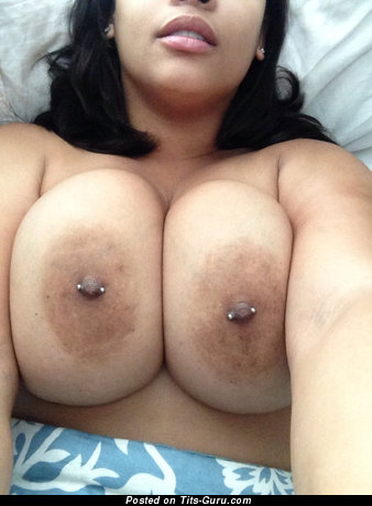 Image. Nude brunette with big natural tittes, piercing and big nipples pic