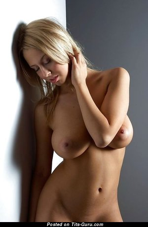 Naked blonde with medium boob image