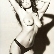 Topless beautiful lady with medium natural tittes image