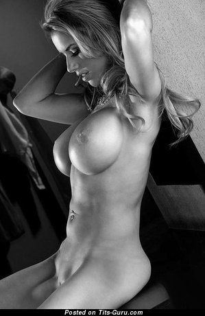 Image. Naked beautiful lady with big fake tittes and piercing image