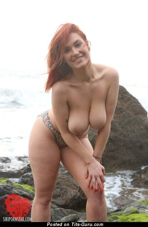 Image. Topless red hair with big natural tittys and tattoo image